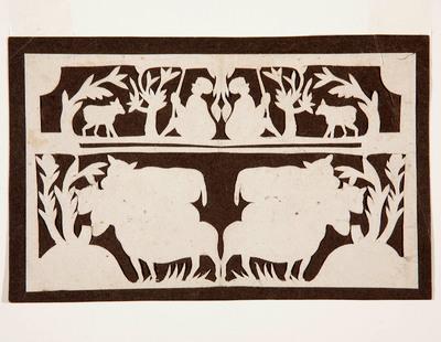 In het symmetrische knipsel zijn in het onderste deel schapen afgebeeld. In het bovenste deel zijn herders met honden te zien.