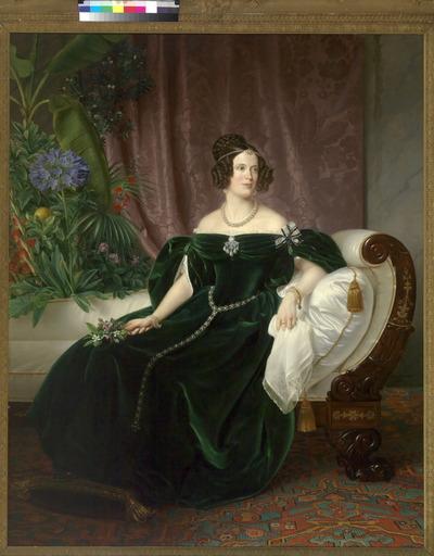Prinses Marianne (1810-1883) is door Theodor Hildebrandt (1804-1874) op uiterst elegante wijze geportretteerd: ten voeten uit, met het gezicht trois-quart naar rechts, zittend op een met witte zijde beklede canapé in Empirestijl. De prinses draagt in het haar een parelsnoer met peervormige parel, eveneens peervormige parels als oorhangers, enkele parelarmbanden, een gouden schakelarmband met turquoise juweel en een broche bezet met diamanten en vijf peervormige parels. Een lange ceintuur van parels in rozetten van zilverkleurige schakels hangt om haar middel. Dit schilderij ontstond in 1837, toen in Duitsland de Middeleeuwen een belangrijke bron van inspiratie voor kunstenaars vormden. De diepgroen fluwelen japon met zijn wijde mouwen en puntige keurslijf roept dan ook herinneringen op aan de tijd van jonkvrouwen en ridders. Ook de fijne schilderwijze en het heldere kleurgebruik plaatsen het schilderij in het tweede kwart van de negentiende eeuw. Maar er is meer. Het is vooral een romantisch portret. Dromerig staart de prinses in de verte met een gelukkige uitdrukking op het gezicht. In haar omgeving heersen liefde en harmonie. Dit wordt ons duidelijk gemaakt door de keuze van de bloemen in het schilderij. Rozen, oranjebloesem, een oranjeappel en een koningsblauwe agapanthus, ook wel liefdesbloem genoemd, verwijzen naar liefde en huwelijk, begrippen die hun materiële bekroning vinden in de gladde gouden trouwring die de prinses duidelijk zichtbaar aan haar linker middelvinger draagt. In 1830 was prinses Marianne, de knappe dochter van koning Willem I, getrouwd met haar neef prins Albert van Pruisen (1809-1872). Hun alliantiewapens zijn geborduurd op de fijne batisten zakdoek, die zij in de hand houdt. De Louise-orde, waarvan zij het draagteken aan een zwart-witte strik op de linkerschouder draagt, bestempelt haar als een lid van het Huis Hohenzollern. Maar ook Marianne's eigen familie wordt niet vergeten. Niet alleen de oranjebloesem in het boeketje, maar vooral ook