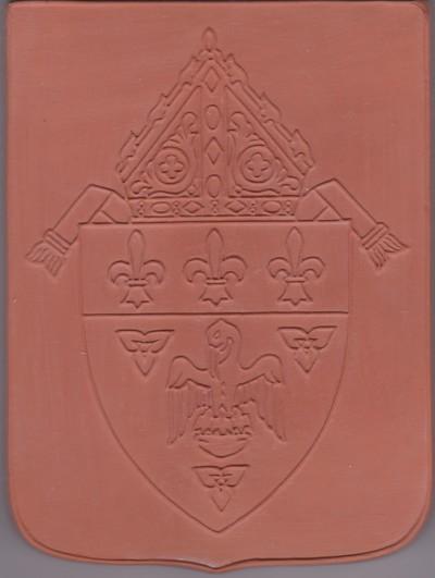 mogelijk is het wapen van een Anglicaanse bisschop, gezien het hoofddeksel