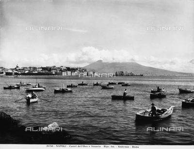 The Gulf of Naples, Mount Vesuvius and the Castel dell'Ovo; some fishing boats are in the foreground