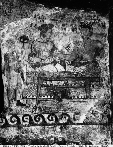Pair of banqueters: detail of the frescoes of the Tomb of the Shields in the Necropolis of Tarquinia