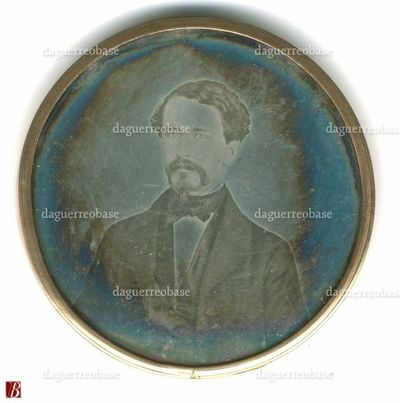 Round plate mounted between two convex shaped glasses of a locket. A strand of hair is mounted on the back of the locket. Collection Andrea Mandarino