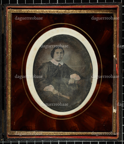 Portrait of a lady with fan