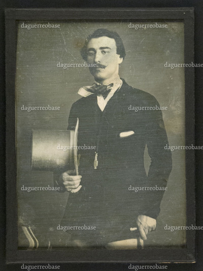 Portrait of an unknown man, holding his tube hat in his hand
