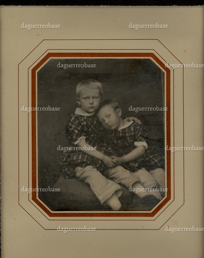 Portrait of two children in a similar dress