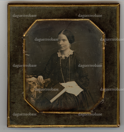 Portrait of an unknown woman, holding a book in one hand