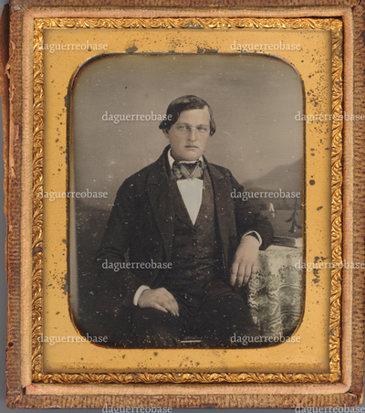 Portrait of an unknown man, in front of painted backdrop