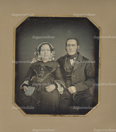 Portrait of an unknown man and woman; the woman is holding a closed book