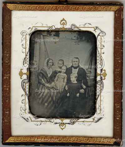 Family group portrait of a man, woman and five children
