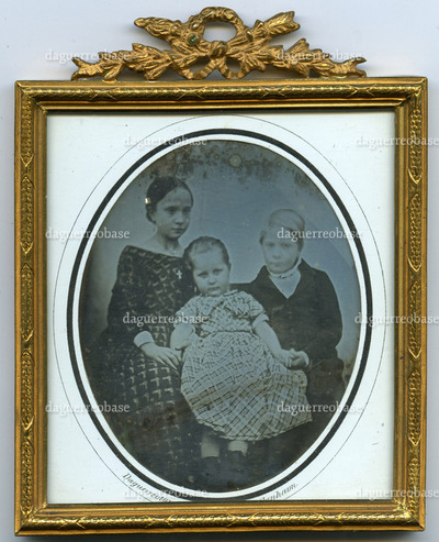 Portrait of three children, two girls and a boy