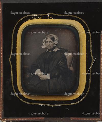 Portrait of an elderly woman, wearing a bonnet