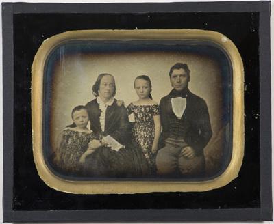 Group portrait of the Nyssum family captured in 1853.  Wilhelmine Albertine Nyssum (05.06.1850 - ), Wilhelmine Christiane Augusta Nyssum (født Ibsen, 30.04.1813 -), Julie Marie Caroline Nyssum (married Krum, 11.07.1844 - ) and Anton Frederik Schou Nyssum (05.07.1817 -).