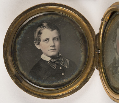 From serie of daguerreotypes in form of case of watches a-portrait of a boy b-portrait of a man c-portrait of a woman (d-pannotype)
