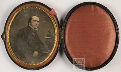 Portrait of a man in oval case