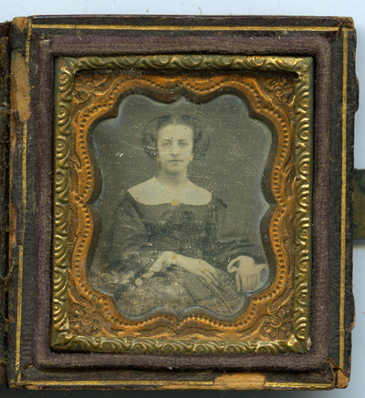 portrait of an unknown woman, wearing jewelry - earrings, brooche, bracelet, rings - jewelry unpainted with gold-colored paint