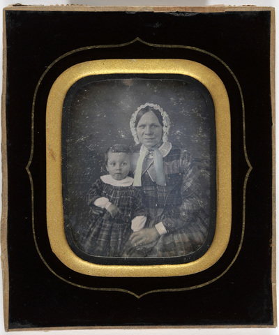 Portrait of an old lady with a lace hat and child