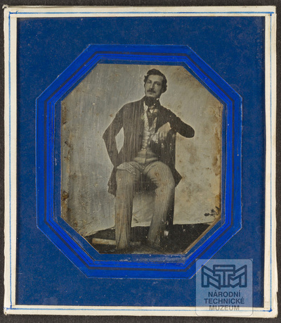 Portrait of man sitting on chair