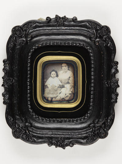 Portrait of a couple: child and a woman