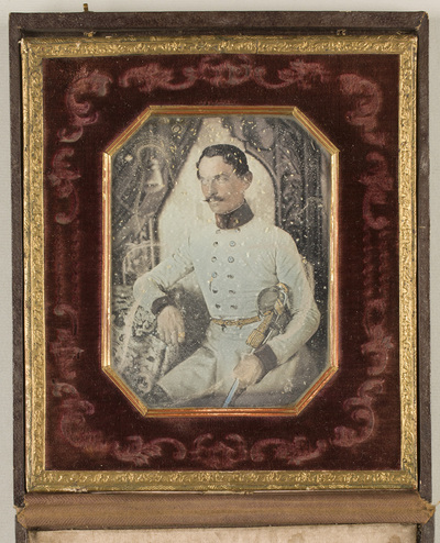 Portrait of an officer, seated, in front of a painted background imitating a drapery