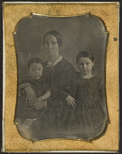 Portrait of a woman with two children