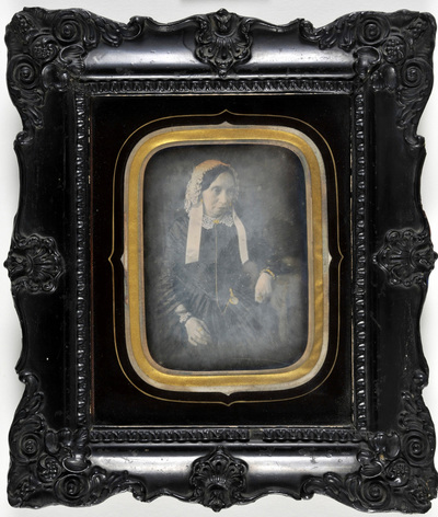 Portrait of a lady with a lace hat