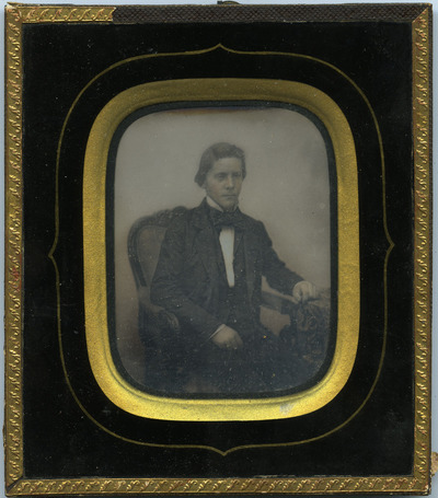 Portrait of a young man, sitting in a chair