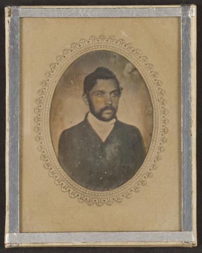 Half portrait of a bearded man