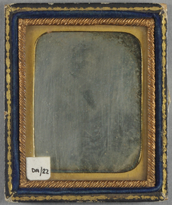 Very faded image. Case looks to be wood covered with black paper, grainy.
