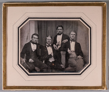 Group portrait of four young men, three of them sitting. 3rd from the left is General Consul Adolf Fredrik Wasenius (Helsingfors 16.1.1829-28.2.1903).