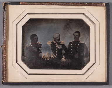 Group portrait of unknown men in uniforms, partly colored. Seal on the back.
