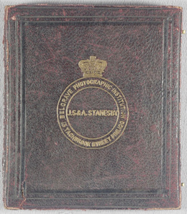 Image missing, this daguerreotype object is the cover of a case which bears the photographer's details.  Although it is stored with 1965-421 it does not belong with this plate.