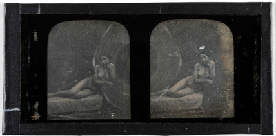 Erotic stereodaguerreotype of a woman lying on a sofa