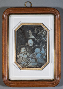 Portrait taken outdoors, The nanny, Dadda, Anna Cassius with twins Hugo and Bruno Sirén, painted portrait of their mother Matilda Sirén on the background.