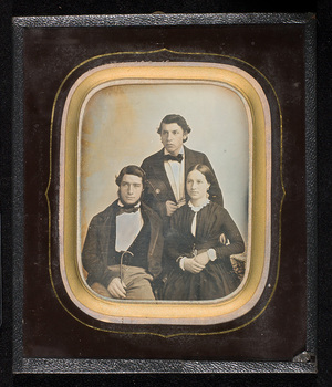 Portrait of three siblings.