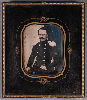 Portrait of unknown man with mustache in uniform.