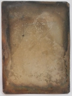 The daguerreotype is in an advanced state of deterioration. The case or frame are missing.