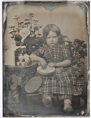 Young girl with a cookie jar.