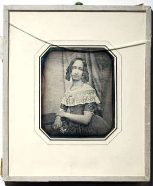 Photographed by C.F. Stelzner? Marie Cathrine Heftye er datter av Johannes Thomassen Heftye (avbildet i daguerreotypi NF.32711-001) og Anna Christine Heftye (avbildet i daguerreotypi NF.32711-002). Samme bakteppe som NFBO.03847 og NFBO.03854?  Marie Cathrine Heftye is the daughter of Johannes Thomassen Heftye (see daguerreotype NF.32711-001) og Anna Christine Heftye (see daguerreotype NF.32711-002). Same backdrop as NFBO.03847 and NFBO.03854?