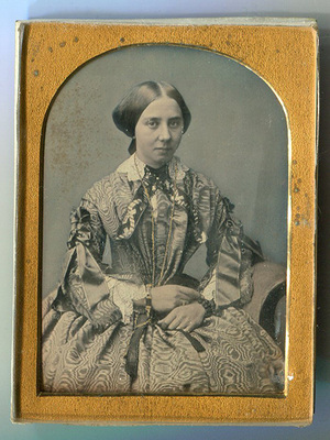 Tinted portrait of young woman on a settle.