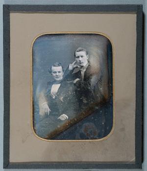 Portrait of two men, sitting man is perhaps merchant Möller from Viipuri.