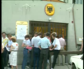 The Hungarian Red Cross Offers Food to GDR Citizens Waitig in front of the West German Embassy