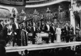 Actuació de John Lubbock dirigint l'Orfeó Català i l'Orquestra de Cambra, interpretant
