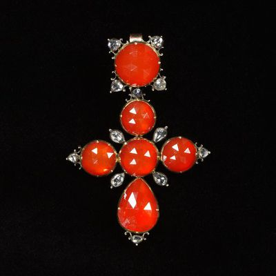 Pendant cross of carnelians and rose-cut diamonds set in gilded silver, made in Germany, about 1720. Pendant cross of carnelians and rose-cut diamonds set in gilded silver.  Carnelians, rose-cut diamonds set in gilded silver.