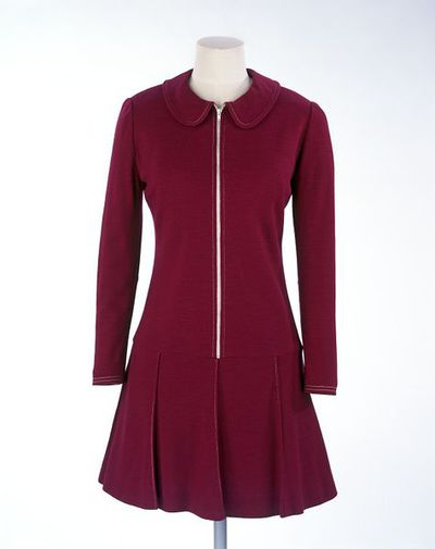 Dress of wool jersey, designed by Mary Quant, London, 1967. Dark pink wool jersey 'skater' dress with zip front and pleated skirt.Wool jersey.