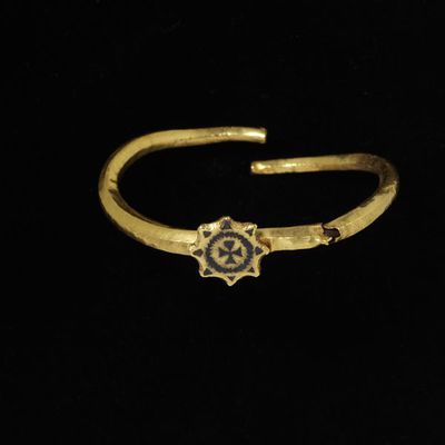 Ornament or child's bracelet, gold, with a star-shaped plaque bearing a cross pattée within a wreath, in niello, Europe (Early Christian), about 3rd century. Ornament or child's bracelet, gold, with a star-shaped plaque bearing a cross pattée within a wreath, in niello.  Gold, niello.