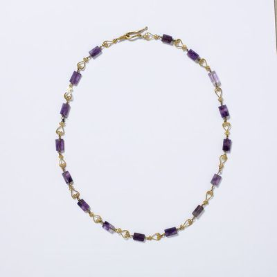 Necklace, lyre-shaped gold links alternating with amethyst beads, made in Europe during the Roman Empire, about 100-200. Necklace of amethyst beads united by lyre-shaped gold links. Gold hook and eye fastening.  Gold, amethyst.