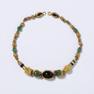 Necklace with female heads, gold, with granulation, garnet, emerald, glass in imitation of onyx and pearl, Greek world, about 200-100 BC. Necklace with female heads, gold with granulation, garnet, emerald, glass in imitation of onyx and pearl.  Gold, emerald and garnet.