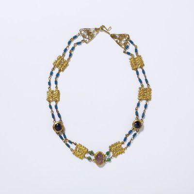 Necklace of gold, amethyst, emeralds and blue glass beads, Europe (Roman), 2nd century. Necklace made with gold, amethyst, emeralds and blue glass beads. French import mark introduced in 1893 for articles form countries without customs conventions.  Gold, amethyst, emerald, blue glass.