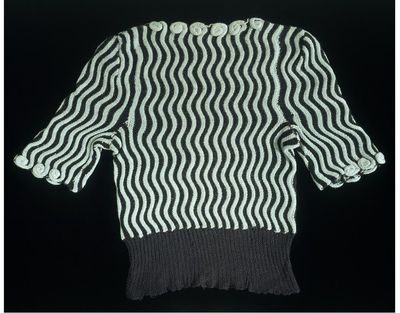 Hand-knitted short-sleeved woollen jumper, Great Britain, 1942. Hand-knitted short-sleeved woollen jumper of alternating wavy black and turquoise stripes. There is a scalloped decoration at the neck.Hand-knitted wool.