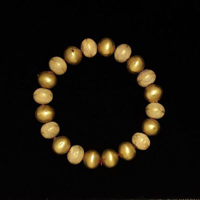 Portion of a necklace, flattened plain and minutely granulated globular gold beads, made in northern Italy (Tuscany or Umbria), Etruscan, 7th-5th century BC. Portion of a necklace formed of flattened globular beads, alternately plain and minutely granulated.  Gold with granulation.